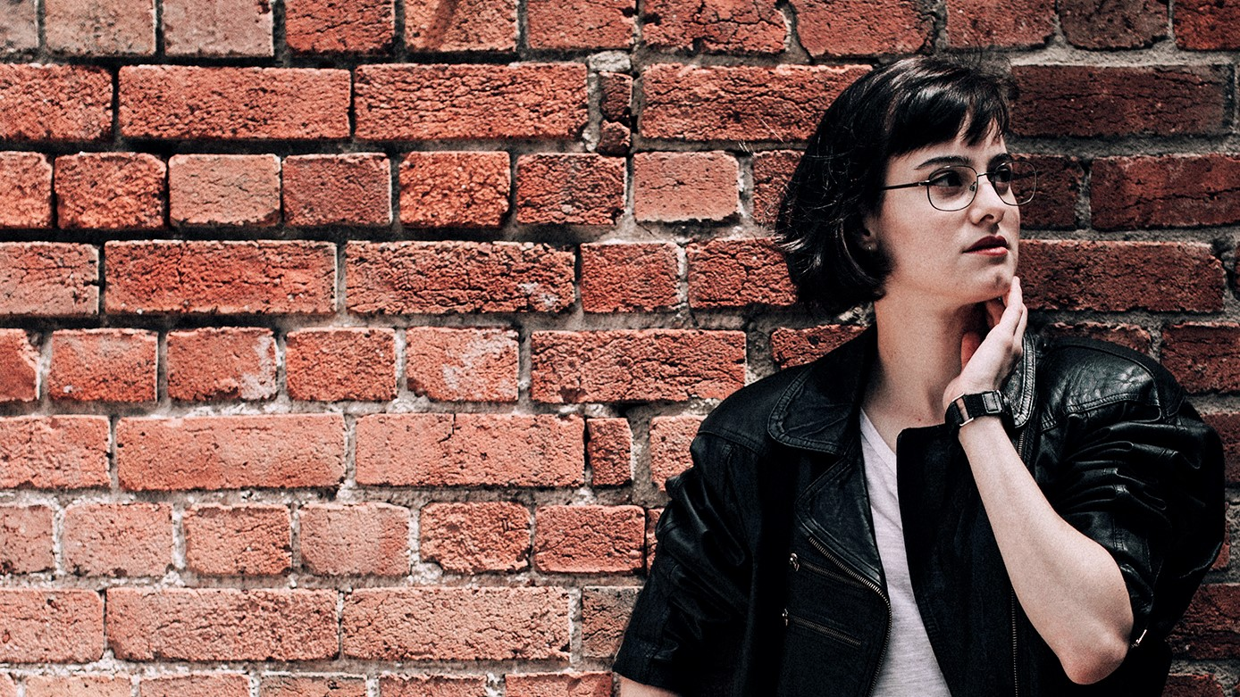 Portrait of me against a brick wall